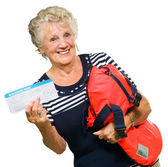 Mature Woman Holding Boarding Pass And Bag — Stock Photo