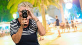 Senior Woman Capturing Photo — Stock Photo