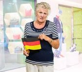Unhappy Senior Woman Holding Germany Flag — 图库照片