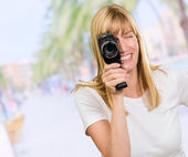 Happy Woman Looking Through Camera — Stock Photo