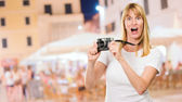 Shocked Woman With Old Camera — Stock Photo