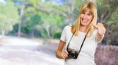 Happy Woman With Old Camera Showing Thumb Up — Stock Photo