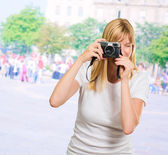 Woman Looking Through Old Camera — Stock Photo