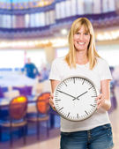 Portrait Of A Happy Woman Holding Clock — Stock Photo