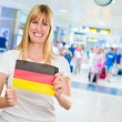 Woman holding a german flag — Stock Photo #19530683