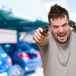 Angry man aiming with guns - Stock Photo