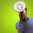 Young Man Shouting On Megaphone - Stock Photo