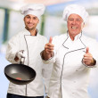 Portrait Of Two Happy Male Chef - Stock Photo