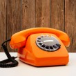 Vintage Orange Telephone - Stock Photo