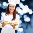 Stock Photo: Womchef holding baked food