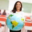 Women holding a globe — Stock Photo