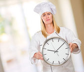 Female Chef Holding Clock — Stock Photo
