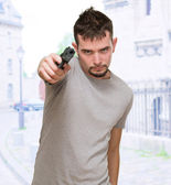 Mad man pointing with gun — Stock Photo