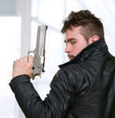 Portrait Of A Man Holding Gun — Stock Photo