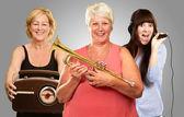 Three Women Enjoying Music — Stock Photo