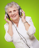 Portrait Of A Woman, While Listening Music — Stock Photo