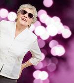 Senior woman wearing sunglasses — Stock Photo