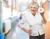 Senior woman holding cd — Stock Photo