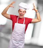 Arg ung man att höja sin hand — Stockfoto