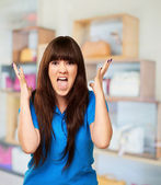 Portrait of a teenager screaming and angry — Stock Photo