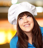 Portrait of a female chef looking up — Stock Photo