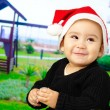 Baby boy smiling and wearing a christmas hat — Stock Photo #19543603
