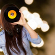 Young Girl Looking At Vinyl — Stock Photo #19540777
