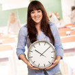 A Young Girl Holding A Clock — Stockfoto
