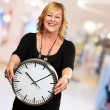 Senior Woman Holding Wall Clock — Stock Photo #19542575