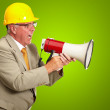 Senior Worker Shouting With Megaphone - Stock Photo