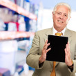 Mature Man Holding Digital Tablet - Stock Photo