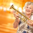 Portrait Of A Senior Woman Holding A Trumpet — Stockfoto