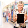 Royalty-Free Stock Photo: Portrait Of A Senior Woman Holding A Digital Tablet