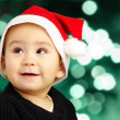 Baby boy wearing a christmas hat and looking up — Stock Photo