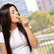 Woman Eating A Cereal Bar - Stock Photo
