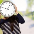 Young Girl Showing Clock And Hiding Her Face — Stock Photo #19544315