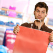 Young Man Holding Shopping Bag — Stock Photo #19549989