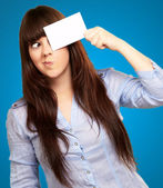 Portrait Of A Girl Holding Paper And Making Face — Stock Photo