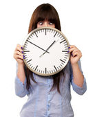 Woman Holding Clock With Squinted Eyes — Stock Photo