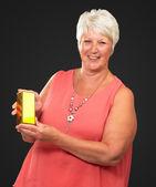 Senior Woman Holding Box — Stock Photo