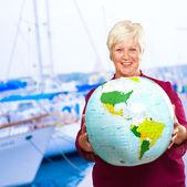 Senior Woman Holding Globe — Stock Photo
