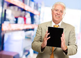 Mature Man Holding Digital Tablet — Stock Photo