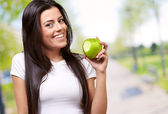 Young Girl Eating Apple — Stock Photo