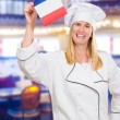 Happy Chef Holding French Flag — Stock Photo #19550025