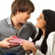 Young Couple Holding Gift — Stock Photo