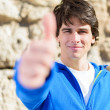 Portrait Of Young Man Showing Thumb-up Sign — Stock Photo