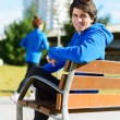 Young Man Sitting On Bench — 图库照片