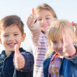 Children Showing Thumb Up Sign — Stock Photo #22625341