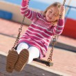 Blonde Girl Swinging In Playground — Stock Photo