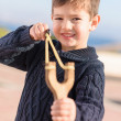 Boy Aiming With A Slingshot — Stock Photo